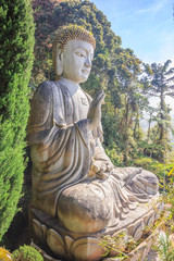 Large stone Buddha statue at Chin Swee Caves Temple in Genting Highlands, Pahang, Malaysia