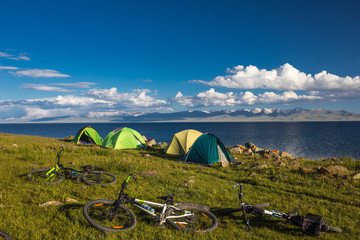 Camping for cyclists on the shore of the beautiful mountain lake Son Kul. Kyrgyzstan.