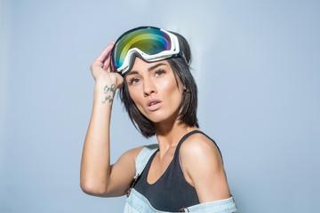 pretty woman in ski goggles or safety glasses