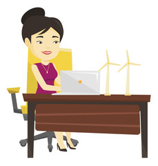 Woman working with model of wind turbines.