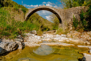 Ancient medieval stone bridge in siena in tuscany