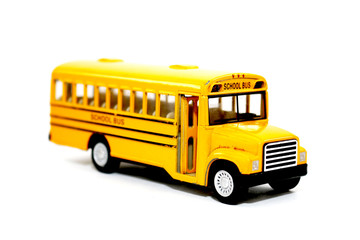 Yellow school bus kids toy on white background