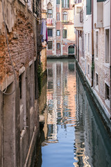 colorful canal in Venice at sunset