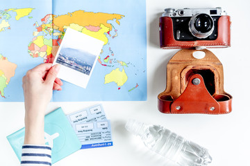journey planning with tourist outfit on white table background top view