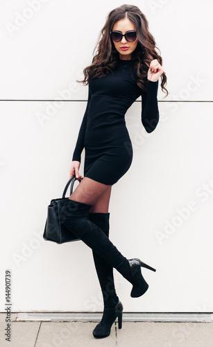 8a16363065fb An incredible fashionable long-legged brunette girl in sunglasses ...