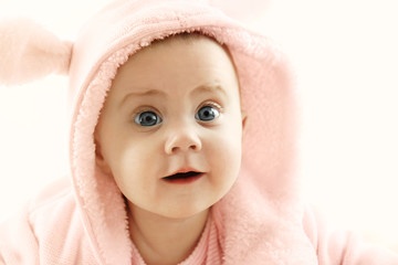 Portrait of adorable baby on white background