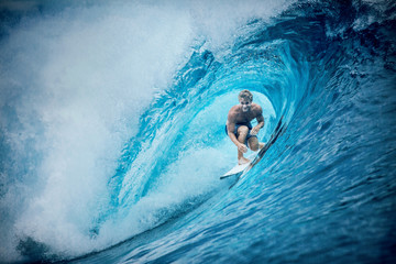 Man surfing wave, Tahiti, South Pacific