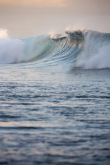 Large scale wave at sunset, Tahiti, South Pacific