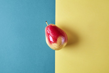 Whole fresh pear fruit view from above on green yellow background, modern style food picture, pattern design