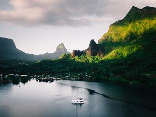 Green mountains, sea and boat, Mo'orea, South Pacific
