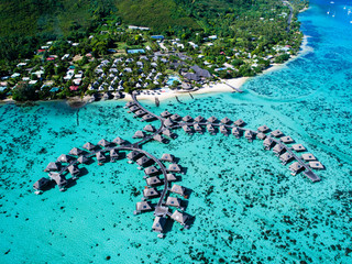 Beach huts in a row on sea, aerial view, Mo'orea, South Pacific