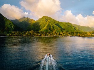 Aerial view of boat on water heading towards island, Teahupoo, Tahiti, South Pacific