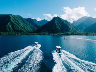 Aerial view of boats on water, heading towards island, Teahupoo, Tahiti, South Pacific