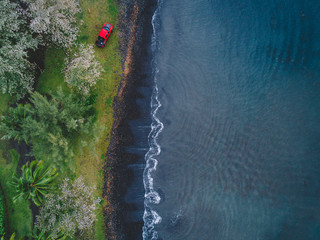 Aerial view of vehicle by water's edge, Teahupoo, Tahiti, South Pacific