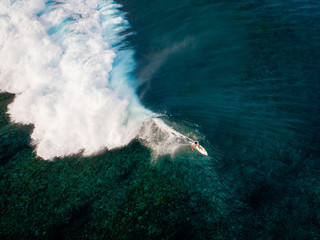 Aerial view of surfer riding wave, Teahupoo, Tahiti