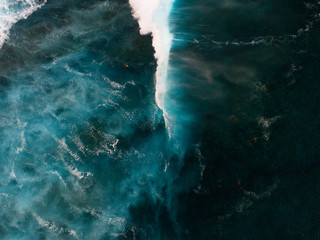 Aerial view of swimmers in choppy sea, Teahupoo, Tahiti, South Pacific