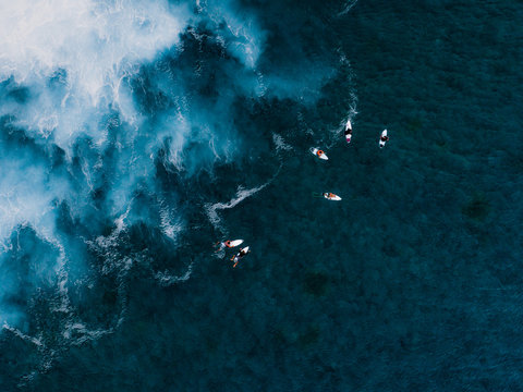 Aerial view of surfers in sea, Teahupoo, Tahiti, South Pacific