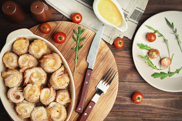 Crockpot with delicious chicken cordon bleu on wooden board