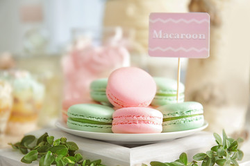 Aluminium Prints Macarons Plate with macarons on wooden stand