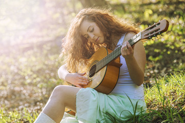 Girl with red hair playing guitar
