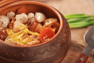 Crock pot with chicken ragout, closeup