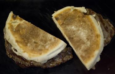 "Steak on Madeira traditional Bread ""Bolo do Caco"""