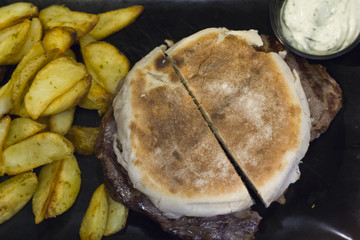 Steak on Madeira traditional Bread with french fries and sauce