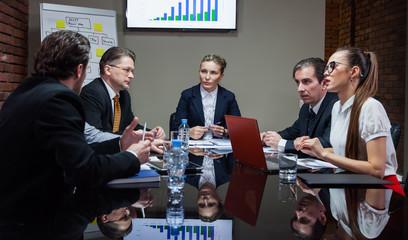 Office workers having meeting