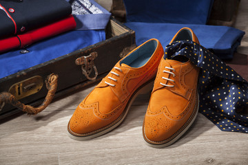 Men suede shoes, accessories, fashionable clothing in the vintage suitcase