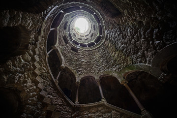 The Initiation well of Quinta da Regaleira in Sintra. The depth of the well is 27 meters. It connects with other tunnels through underground passages. Sintra. Portugal