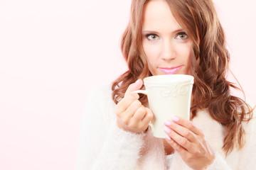 Autumn woman holds mug with coffee warm beverage
