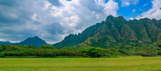 "Panorama of the mountain range by famous Kualoa Ranch in Oahu, Hawaii where  ""Jurassic Park"" was filmed"