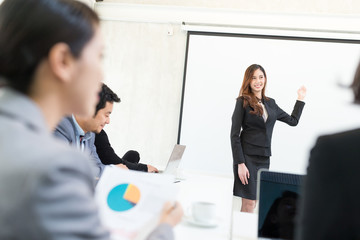 Businesswoman having presentation in conference room