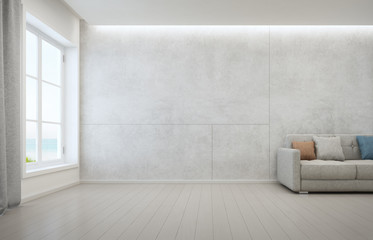 Wall Mural - Sea view living room with wooden floor and concrete wall background in modern beach house, White interior of vacation home - 3D rendering