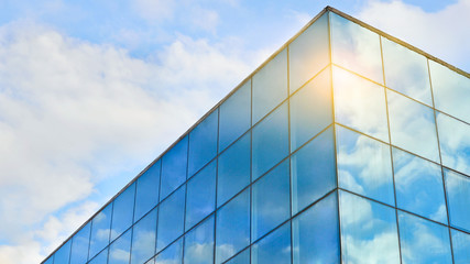 Blue sky with white clouds reflected in the windows. Abstract background for business purposes.