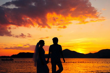 Silhouettes at sunset on the beach in Montenegro