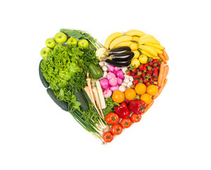 Heart made out of fruits and vegetables isolated on white background