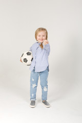 pretty little blonde girl with soccer ball