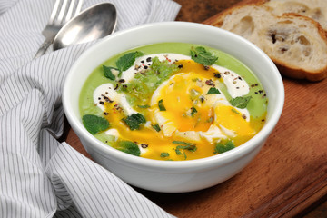 Pea puree soup with poached egg  and peppermint