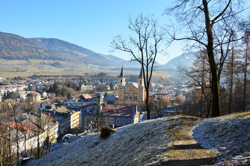 Amazing winter view of Brunico with Santa Maria Assunta church in the middle of the picture, Bruneck, Italy
