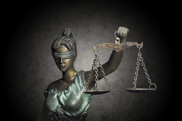 Lady Justice on grunge background