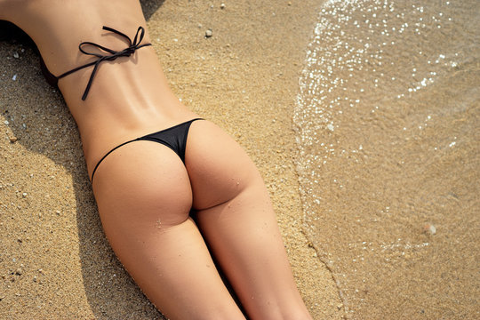 Summer vacation.. Sexy female buttocks on the beach.