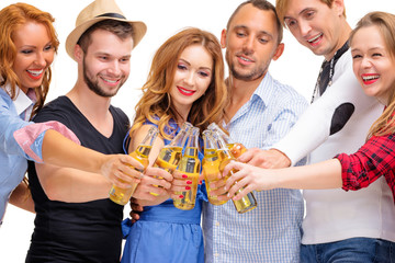 Party and relax. Group of six happy smiling friends with bottles of beer having fun together. Isolated on white.