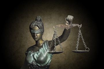 Lady Justice on grunge brown background