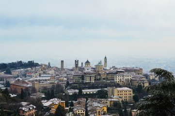 Amazing view of Bergamo city with snow on the old upper city, Italy