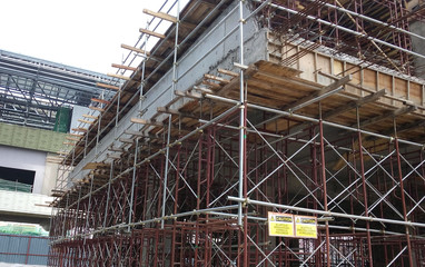 Timber form work and scaffolding used by construction workers at the construction site in Johor, Malaysia. Timber form work  made from timber and plywood