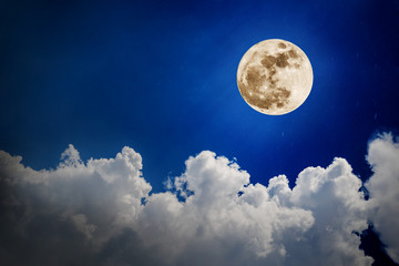 Beautiful Night sky and a full moon in the clouds