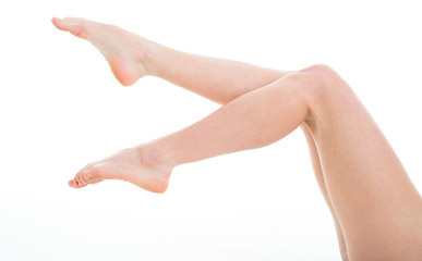Long pretty woman legs, isolated on white. Beautiful female legs after depilation.