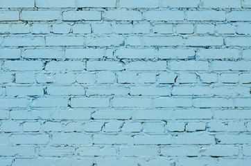 Texture of an old light blue brick wall.