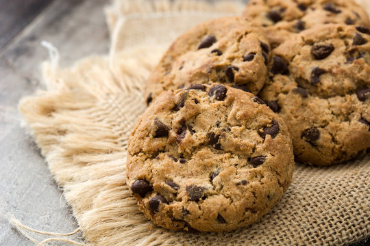Close up chocolate chip cookies on wooden table background